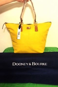 Dooney & Bourke O-ring Sunflower Yellow And Saddle Brown Tote Bag. Get one of the hottest styles of the season! The Dooney & Bourke O-ring Sunflower Yellow And Saddle Brown Tote Bag is a top 10 member favorite on Tradesy. Save on yours before they're sold out!
