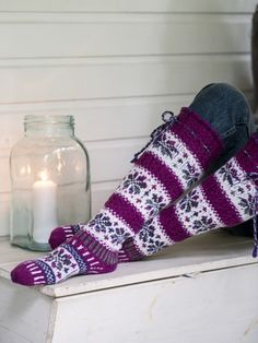 Showy floral fair isle socks are worked in Novita 7 Veljestä Brothers) and 7 Veljestä Raita Brothers Stripe) yarns. Choose your favorite colors, these socks would make a marvelous gift! Knitted Boot Cuffs, Knit Boots, Knitted Slippers, Wool Socks, Crochet Socks, Knitting Socks, Hand Knitting, Knitting Patterns, Knit Crochet