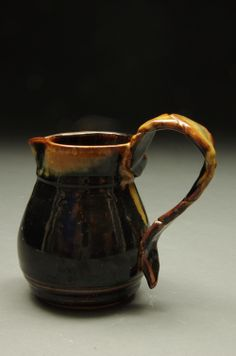 Lovely jug with a delicate looking handle. Handle was folded over itself before being attached to give a unique look. Red stoneware reduction fired to Cone 10 Available for purchase Stoneware, Delicate, Handle, Pottery, Sculpture, Unique, Red, Ceramica, Pottery Marks