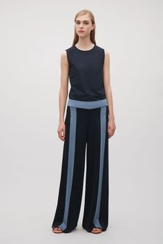 COS image 1 of Trousers with contrast stripes in Dark Navy
