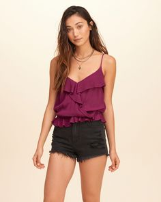 A crossover cami with ruffle neckline and hem, featuring adjustable straps and cinched waist, Easy Fit, Imported