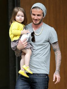 Sporting a gray tee, sexy jeans and one very fashionable candy necklace, David Beckham enjoys a trip to the Louis Vuitton store in Paris with daughter Harper, 21 months. http://www.people.com/people/gallery/0,,20697235,00.html#21318483