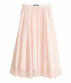 H&M Een licht uitlopende, kuitlange rok van fijne kwaliteit met een tulen onderrok en een band van geribde kwaliteit en platte plooien in de taille. De rok is gevoerd en heeft een blinde rits en een haak-en-oogsluiting aan de zijkant.