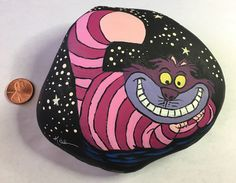 Cheshire Cat painted rock -by Kerry
