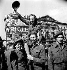 Karen Hermeston, the first female photographer in the Canadian Army, is shown riding on a soldier's shoulders during the VJ-Day celebrations in Piccadilly Circus, London, on August 10, 1945. (Photo Credit: Library and Archives Canada). For more about her life: www.elinorflorence.com/blog/women-ww2.
