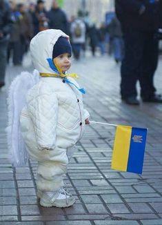 little Angel of Ukraine. toddler. girl. costume flag wings. snowsuit