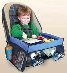 Travel tray for car trips from Sensational Beginnings **We have this now and it's ok, but like the reviews say it's rather soft to write on, and my daughter doesn't like that it clips behind her back**