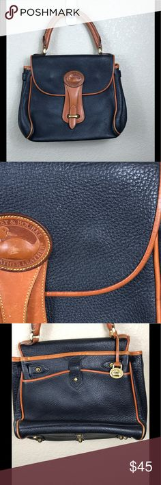 Vintage AWL Downey and Bourne Purse Navy Brown The original! Downey and Bourne Navy Purse, with Brown accents. Honestly, they don't produce purses like this anymore. Supple leather with heavy duty brad feet. The only flaw with this purse is the Duck emblem has some war. Just adds to the charm of this AWL. You won't regret buying this purse! No trades, but I do negotiate. Smoke free/pug friendly Dooney & Bourke Bags