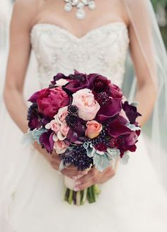 A mixture of light roses paired with deep burgundy blooms and berries creates a visually stunning arrangement. Fall Wedding Bouquets, Floral Arrangements, blush wedding ideas, bridal bouquets