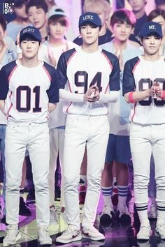 Suho, Sehun, Xiumin..... Jesus, I love these boys in uniforms!!!!