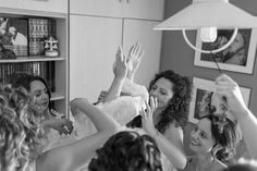Friends of the bride help her get dressed for the big day!