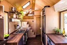 Adorable (and super efficient) tiny house with a sun-drenched bed loft.