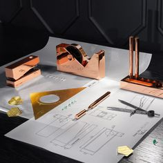 British designer Tom Dixon's latest range of accessories includes copper stationery and containers with magnifying-glass lids