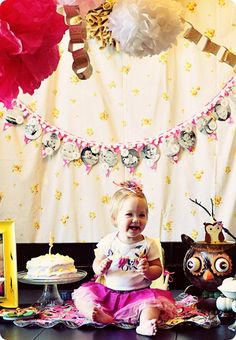 I love the garland idea with the photos through out the year. Also love the newsprint paper chain.