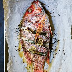 This whole fish stuffed with herbs, lemon and aromatics is easy to prepare and makes a gorgeous, hands-off main dish.