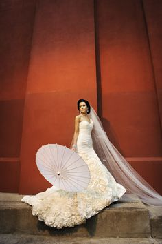 Gorgeous bridal photo... dramatic gown without the prop, but the umbrella is fun
