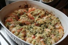 Ina's baked shrimp scampi.   Shrimp, butter, garlic, panko bread crumbs... this sounds delicious. I liked this website's photo much better than Food Network's. This was originally Ina Garten's (Barefoot Contessa).