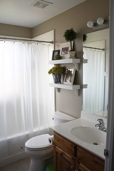 maybe for the downstairs bathroom - remove towel bar and replace with 2 shelves???