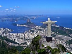 This statue of a religious figure stands high above a South American city.