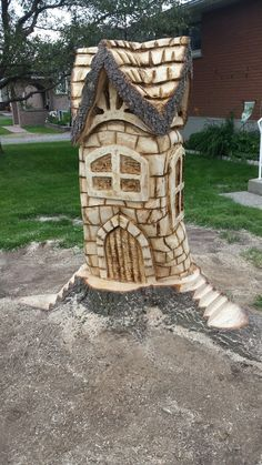 Chainsaw carved whimsical house