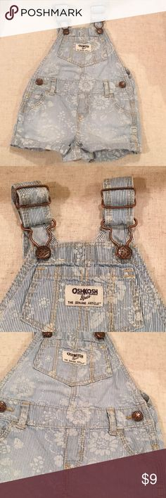 OshKosh Baby Girl Overall Shorts Baby Girl shorts/ overalls. White with light blue stripes with flower work. In great condition! OshKosh B'gosh One Pieces