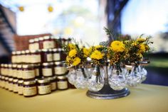 Yellow flowers with honey as wedding party favors