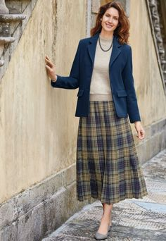 "Maureen, our Mail Order Operator, loves this check pleated skirt for its ""classic style and seasonal hues."""