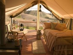 Inside an Outfitters Wall Tent. this is how you go glamping. awesome