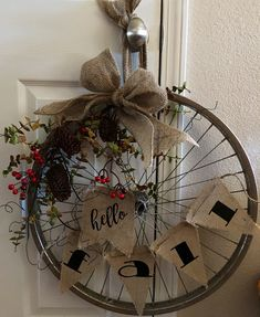 Hello Fall Bike wheel wreath I am obsessed with creating bike wheel wreaths! I know it's early, but I just had to give a fall design a go! Find this wreath on my Etsy store: Simply Rustic 307 Bicycle Decor, Bicycle Rims, Bicycle Wheel, Bicycle Art, Bike Wheels, Book Wreath, Diy Wreath, Fall Wreaths, Christmas Wreaths