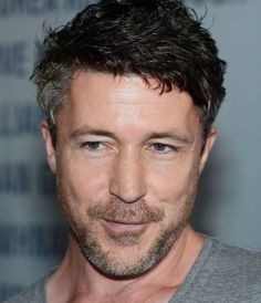 Stuart Jones, aka Aidan Gillen, is growing up, but still a scamp. Look at that expression!