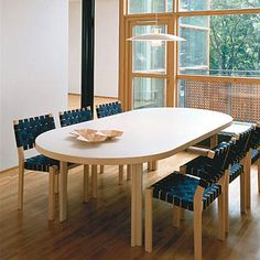 Smart and stylish, these stackable chairs come in a variety of webbing colors. Artek Alvar Aalto - 611 Stacking Chairs