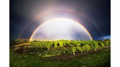 """Double Rainbow"""": A perfect double rainbow, F:11 8mm lens. HDR, exposure bracketed. (Submitted by Larry Bennett)"""
