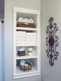 Built-In Storage Between the Studs/HomeStagingBloomingtonIL ---- DIY project to add more storage to your bathroom or any room where storage or interest is needed! #BathroomStorage #SmallBathStorageSolution #DIYbathroomShelving