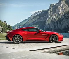 The Vanquish by Zagato recently has unveiled by Aston Martin at the Concorso d'Eleganza Villa D'Este. The Vanquish is the result of Aston Martin teaming up with Italian design ho… Aston Martin Vanquish, New Aston Martin, Aston Martin Cars, Bugatti Veyron, My Dream Car, Dream Cars, Mustangs, Audi, Automobile