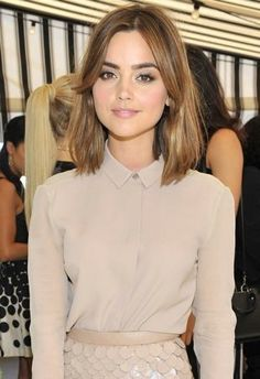 Jenna Coleman kept things relatively monochromatic in a nude shirt and a sequin scallop pencil skirt.