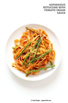 Fettuccine with Tomato Cream Sauce and Asparagus. Easy tomato Cream sauce with pasta and garlic roasted Asparagus. Use other veggies of choice. Add some chickpea chorizo or smoked coconut for variation. Vegan Soyfree Recipe. Can be gluten-free with gf pasta. | VeganRicha.com