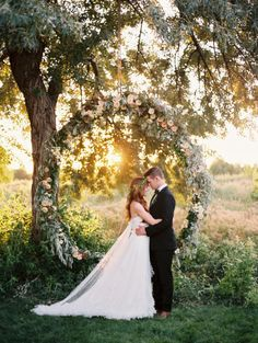 Just incredible: http://www.stylemepretty.com/little-black-book-blog/2014/12/03/organic-giant-wreath-wedding-inspiration/ | Photography: Leo Patrone - http://leopatronephotography.com/