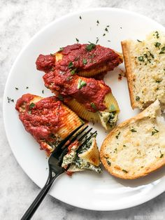 Pesto Stuffed Shells are an easy and impressive dish that is a filling and flavorful alternative to a meat-heavy Italian meal. BudgetBytes.com