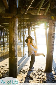 Engagement pictures idea--at beach and under the pier
