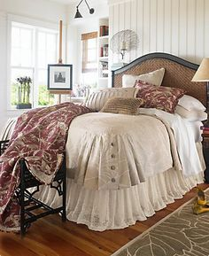 Oh My, this bedding is awesome! The buttons on the corner, the flowing bed skirt, the redish punch in the throw & the pillow