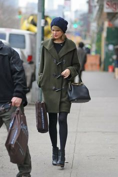 Shop Taylor Swift's look for $242:  http://lookastic.com/women/looks/duffle-coat-and-shopper-handbag-and-beanie-and-longsleeve-shirt-and-tights-and-ankle-boots/1636  — Dark Green Duffle Coat  — Black Leather Shopper Handbag  — Navy Beanie  — Black Longsleeve Shirt  — Black Tights  — Black Leather Ankle Boots