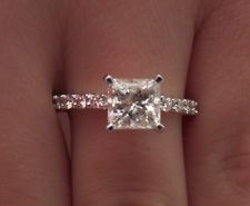 solitaire princess cut engagement ring - diamond band- this is PERFECT! maybe a 3 stone with the diamond band-