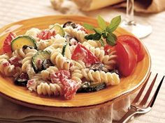 Toss a zesty Italian yogurt dressing with tomatoes, zucchini and pasta for a colorful and delicious salad.