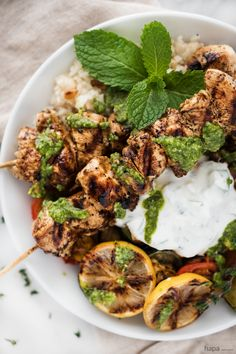 Want to know the trick for super moist and tender chicken? Chicken Souvlaki with Lemon Scented Rice & Roasted Veggies, Creamy Tzatziki, and a Drizzle of Pesto make this full plate flavor experience!