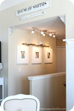 I love the lights pointed right at the pictures hanging in the hallway #decorate #pictures