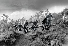 War Comes to Capa by Robert Capa shows the devastating affects of war physically and mentally. This picture is very moving as you can see there is a squad of army men carrying away a fellow troop member and trying to get him to safety.