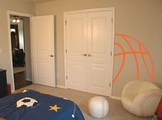 This great basketball lines wall decal gives a great look to a sport themed room! Abstract lines in the corner of the room or up against a doorway look like the basket ball is coming out of the wall! Add some basketball love to his bedroom today! Boy Sports Bedroom, Basketball Bedroom, Basketball Wall, Toddler Rooms, Baby Boy Rooms, Kids Rooms, E Room, Wall Decals For Bedroom, Room Themes