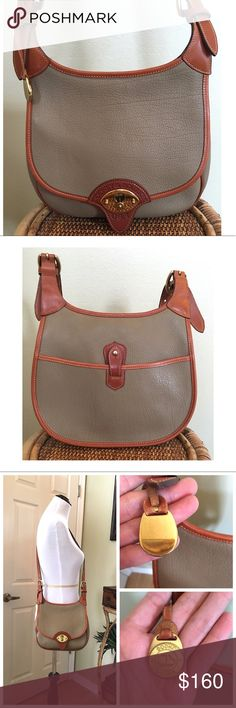 """VINTAGE DOONEY AND BOURKE CAVALRY SADDLE BAG Vintage D&B Cavalry Saddle Bag R 71 in Taupe w/ British Tan Trim.  This bag is in fantastic condition w/ minimal wear to the piping. Some wear to the brass hardware. Super clean interior and exterior.  There is no interior serial tag due to this being a pre-tag bag.  1 interior zipper pocket with 4 cc slots.  ALL MEASUREMENTS ARE APPROXIMATE: 9.5"""" L X 9.5"""" H X 3.0"""" D.  ADJUSTABLE STRAP 18.0""""-22.0"""" (SEE ALL PICTURES) Dooney & Bourke Bags"""