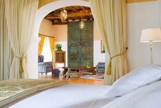 A bedroom in the Ibizan retreat Cas Gasi, a fashion favourite set in four acres of Mediter...