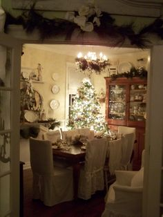 Christmas dining room with garland over entry